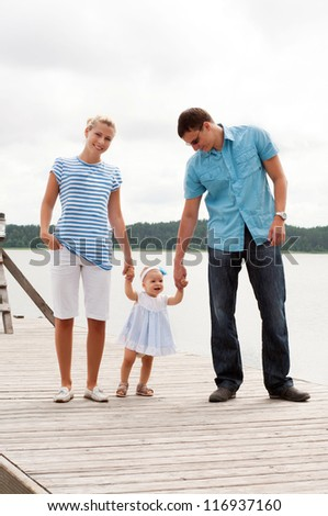 Happy family on the river bank