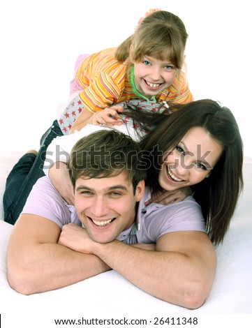 Happy family on white bed. Isolated.