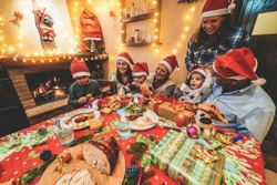 Happy family opening christmas presents - Children having fun in winter holidays laughing together with grandparents - Cosy, love and vacation concept - Focus on grandmother face