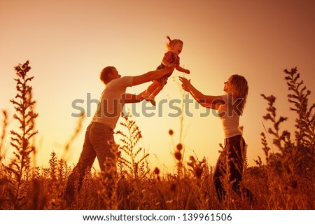 happy family outdoor, silhouettes on sunset #139961506