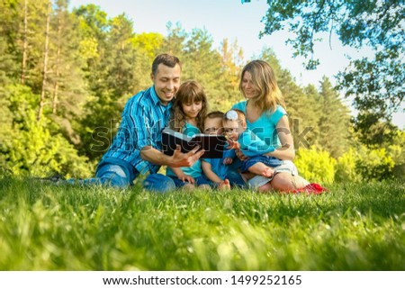 happy family outdoors in the park #1499252165