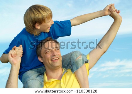 Happy family outdoors on blue sky background
