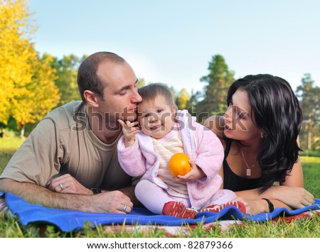 happy family outdoors on grass