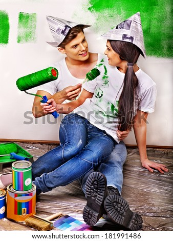 Happy family paint wall at home.