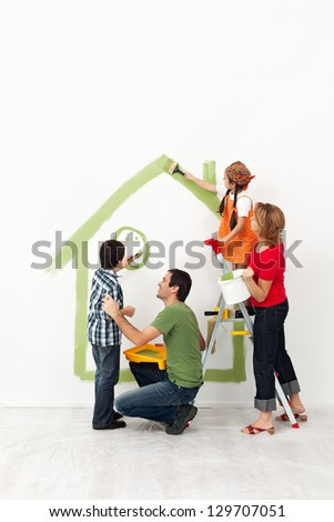Happy family painting their home together with the kids