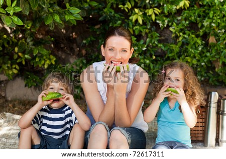 Happy family picnicking in the garden