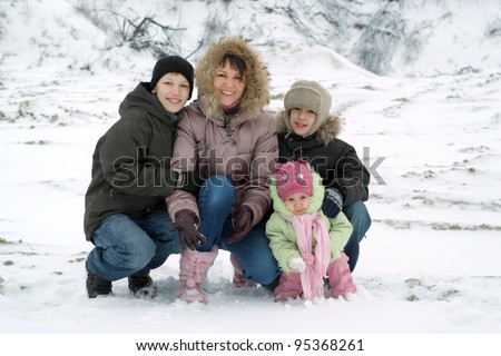 happy family play against the backdrop of the snow