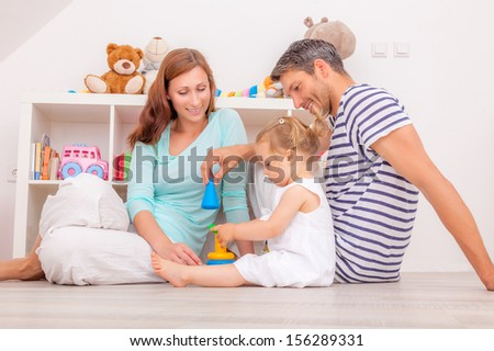 happy family playful with little daughter