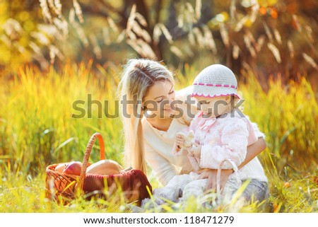 Happy family playing in autumn park outdoors