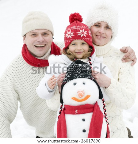 Happy family playing in snow