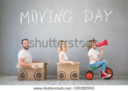 Happy family playing into new home. Father, mother and child having fun together. Moving house day and express delivery concept #590280983