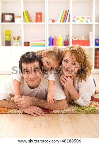 Happy family portrait - laying on the floor in the kids room