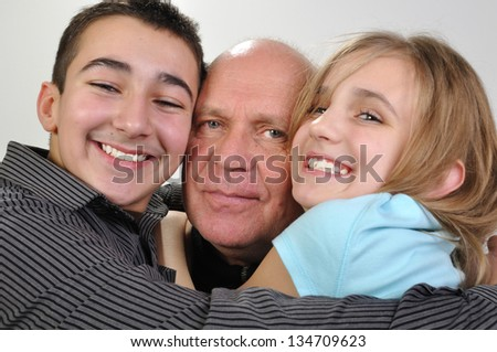 happy family portrait of elderly father with his daughter and son