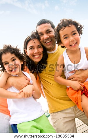 happy family portrait outdoors during a holiday - togetherness concept