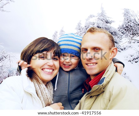 Happy family portrait outdoors smiling. Winter