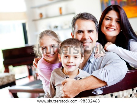 Happy family portrait smiling together at home
