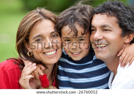 happy family portrait standing outdoors smiling