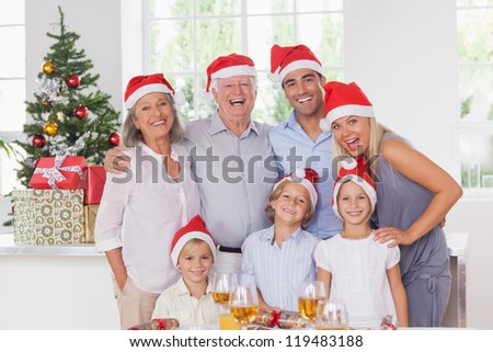 Happy family posing for photo at christmas