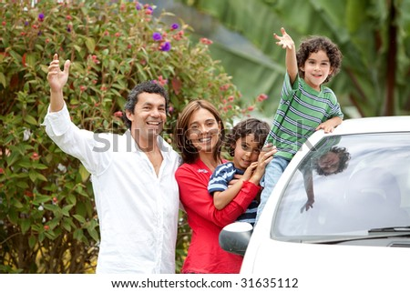 Happy family ready to go for a ride on their car