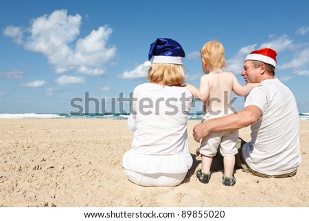 Happy family resting on the sea on the eve of new year