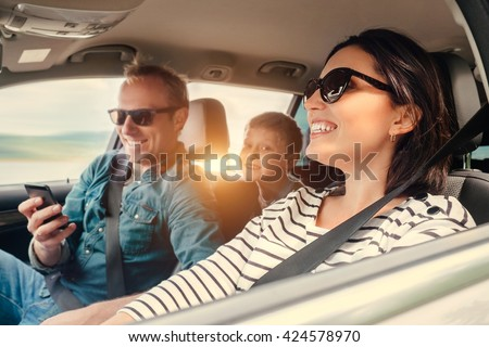 Happy family riding in a car #424578970