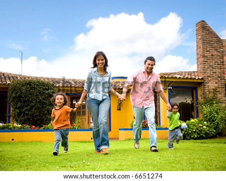 happy family running and having fun outdoors smiling and enjoying