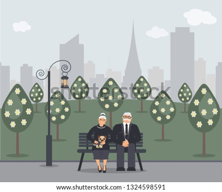 Happy family seniors: cute smiling elderly man and woman with pug are sitting on bench in park. Retired elderly couple in love.Trees, cityscape and ancient lantern.