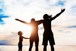 Happy Family Silhouette with Hands Up on the Nature Background