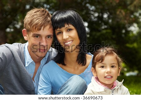 Happy family sitting in a park