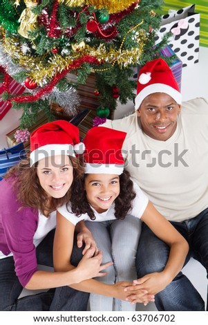 happy family sitting near Christmas tree