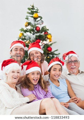 Happy family sitting on couch at christmas