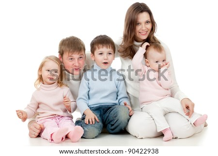 happy family sitting on floor and looking sideways (TV) with great interest