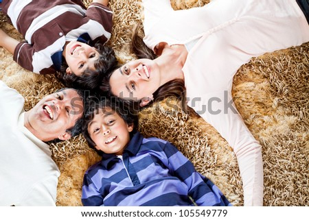 Happy family smiling and having fun at home