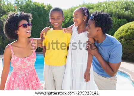 Happy family smiling at each other in the garden at home