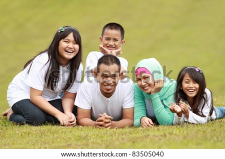 Happy family smiling having a great day in park