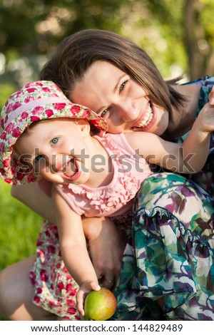 Happy family. Smiling Mother and her daughter in summer park.