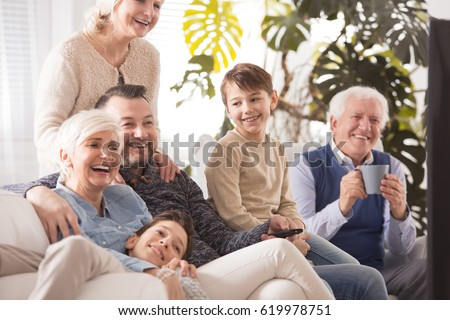 Happy family spending afternoon together, watching TV #619978751