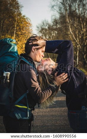 happy family spending good time together outdoors having fun on nature park background. Man holding kissing woman in love relaxing in countryside summer vacation travel. Togetherness happiness