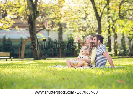 Happy family spending time together in the park