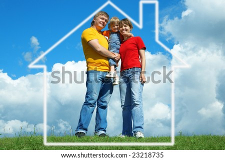 happy family stand in house on green grass under sky with clouds