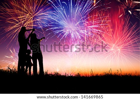 happy family standing on the hill and watching the fireworks #141669865