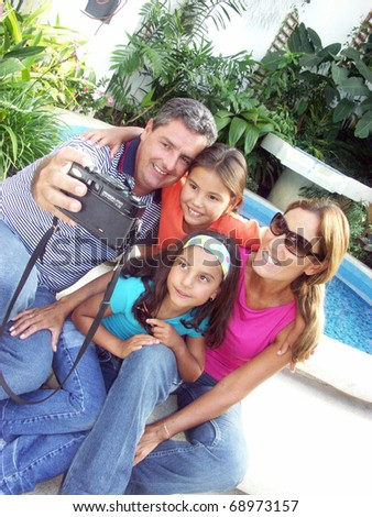 Happy family taking pictures.