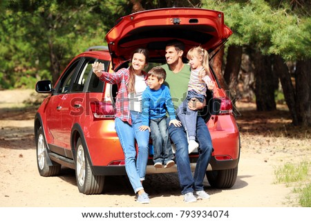Happy family taking selfie near modern car outdoors
