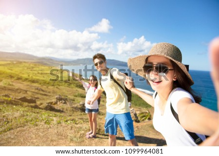 happy family taking selfie on the coast