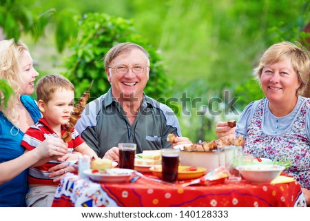 happy family together on picnic, summer outdoors