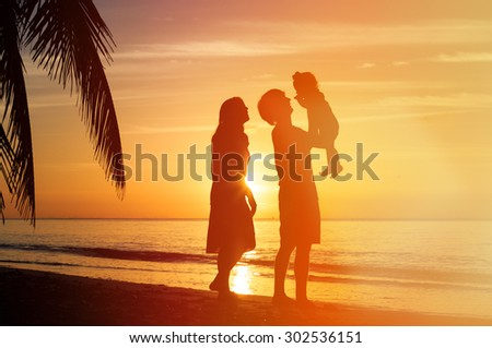 Happy family together, romantic couple with little child at sunset tropical beach #302536151