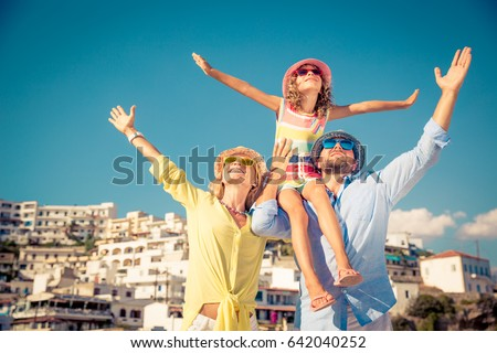 Happy family traveling. People having fun in old european town. Summer holiday and vacation concept