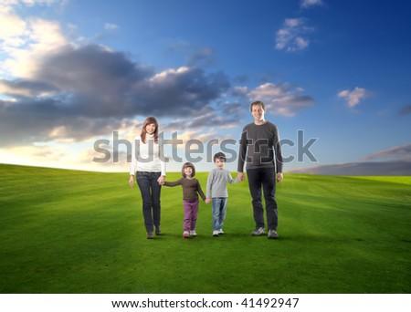 happy family walking in a grass field