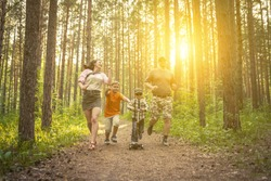 happy family walking in the forest