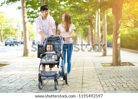 2fc97e5d98c9 Free photos Portrait of a happy mother and father pushing baby pram ...